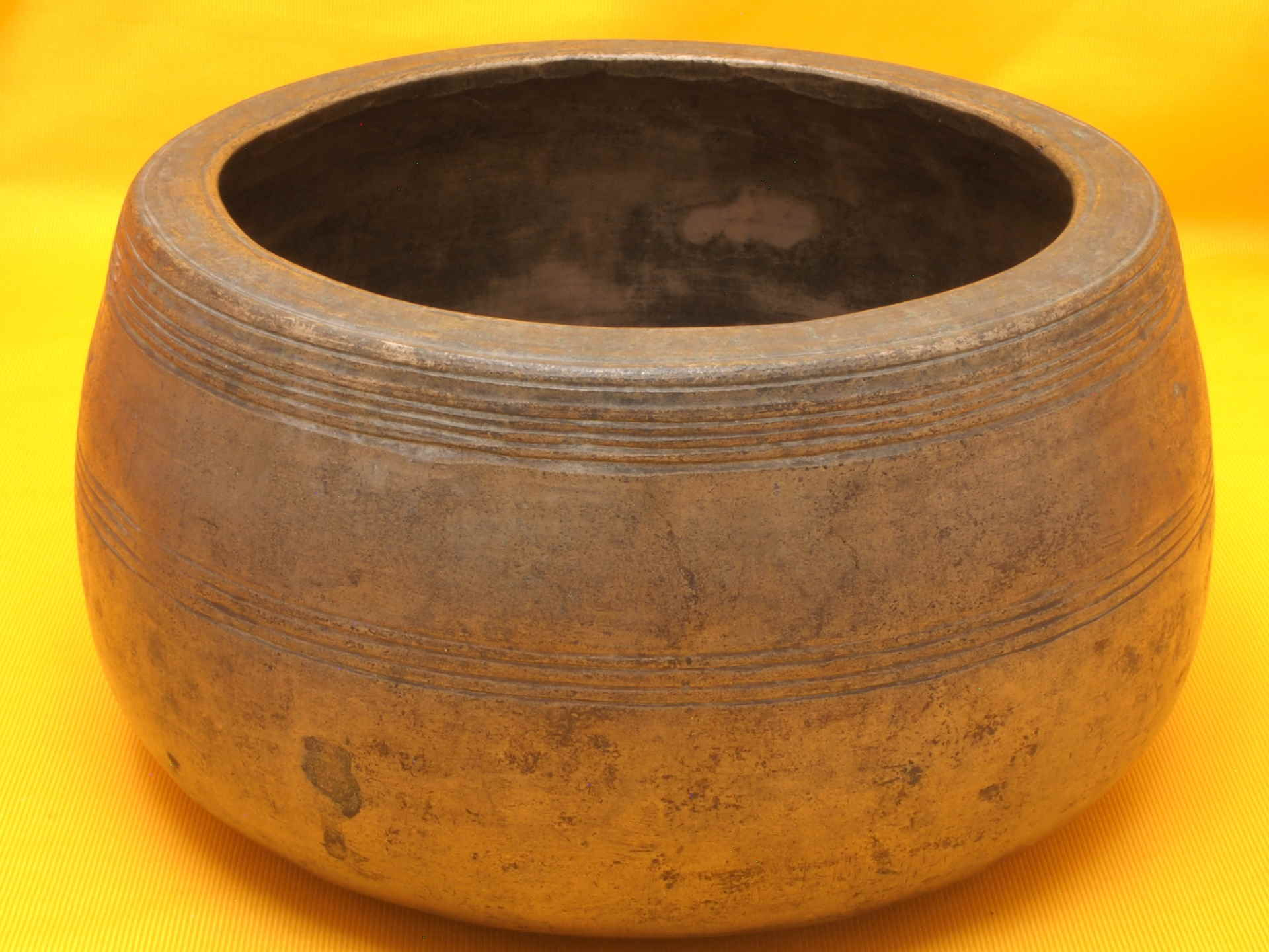 XX Thick Huge Antique Mani Singing Bowl with lots of worn artwork.