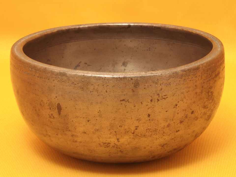 Adorned Antique Thadobati Singing Bowl whose pitches bounce and twirl